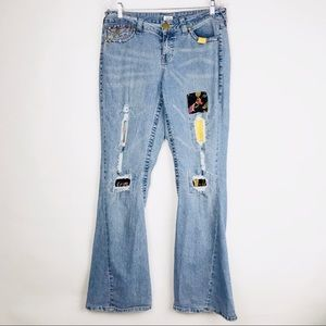 Cache Flare Patch Distressed Boot Cut Jeans